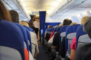 people sitting inside airplane