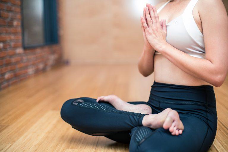 Woman Doing Yoga on a Mat