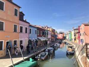 multicolored houses on river in burano