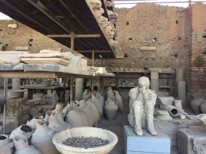 person and pottery in pompeii