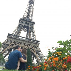 man and woman kissing next to Eiffel Tower