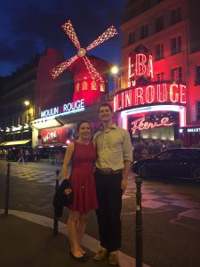 man and women outside moulin rouge