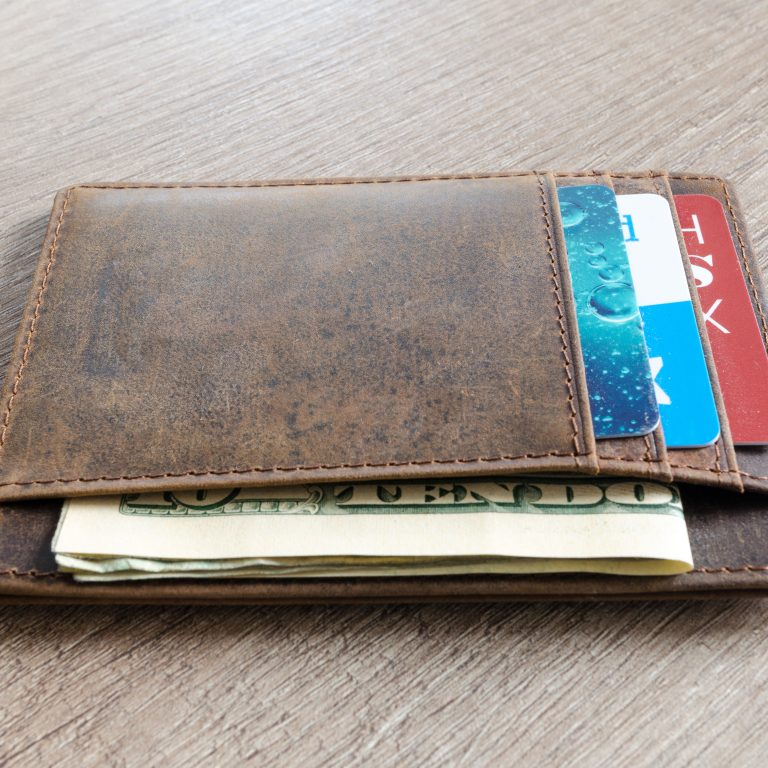 Leather wallet on wooden table