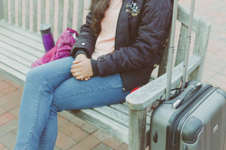 Woman Wearing Black Jacket with suitcases