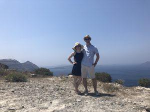 man and woman smile in Santorini greece