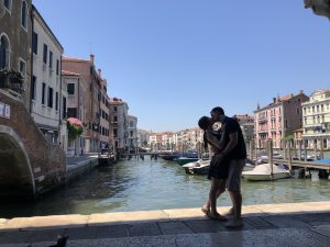man and woman kissing in venice