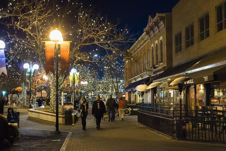 People walking in the Old Town pedestrian zone of Fort Collins, Colorado at night