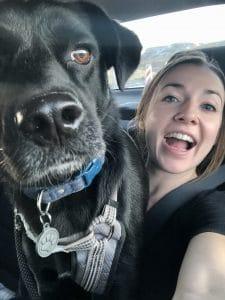 black dog and girl
