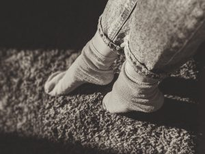 Gray Socks on carpet