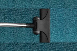 Top View of a Vacuum Cleaner Cleaning a Carpet