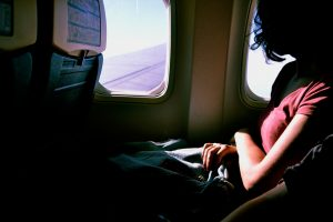 Woman by the Airplane Window Seat