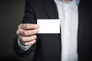 person holding blank card