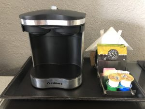 coffee maker, creamer, and sugar in hotel room