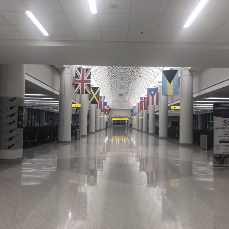 Empty airport terminal with country flags