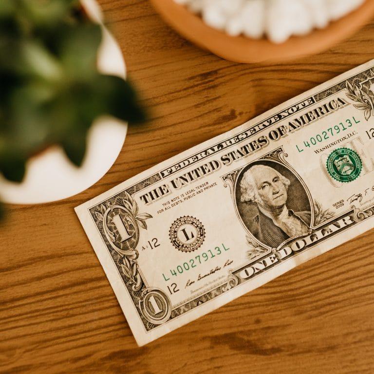 1 Us Dollar Bill on Table