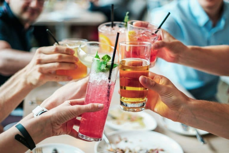 group of people cheering with drinks